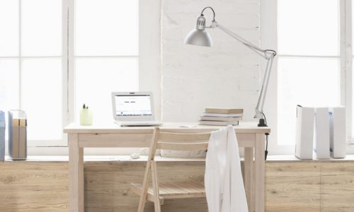 Desk in window area of loft apartment --- Image by © Vladimir Godnik/moodboard/Corbis