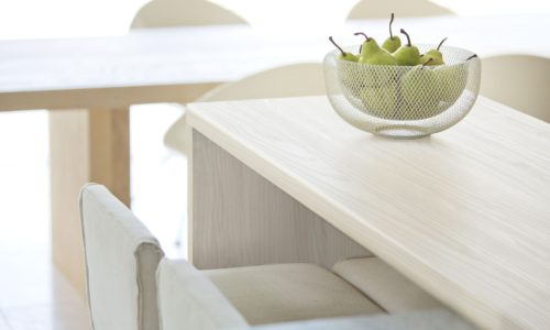 Pears in bowl on modern table